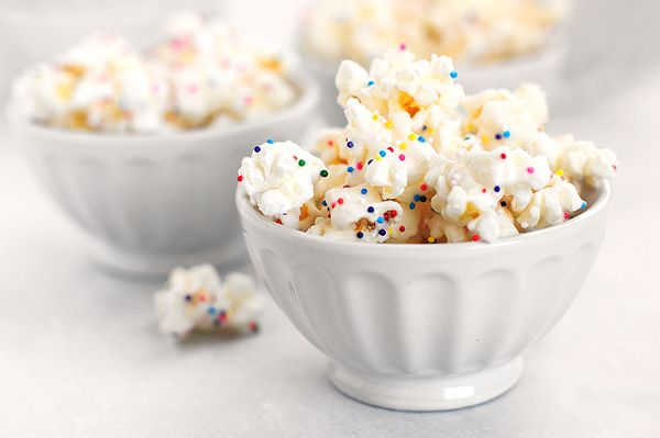White chocolate covered popcorn with sprinkles