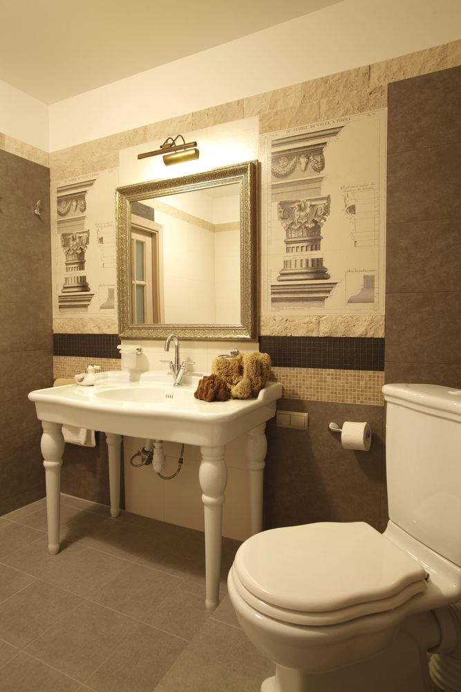 Large Powder Room Design With Free Standing Vanity And Mirror