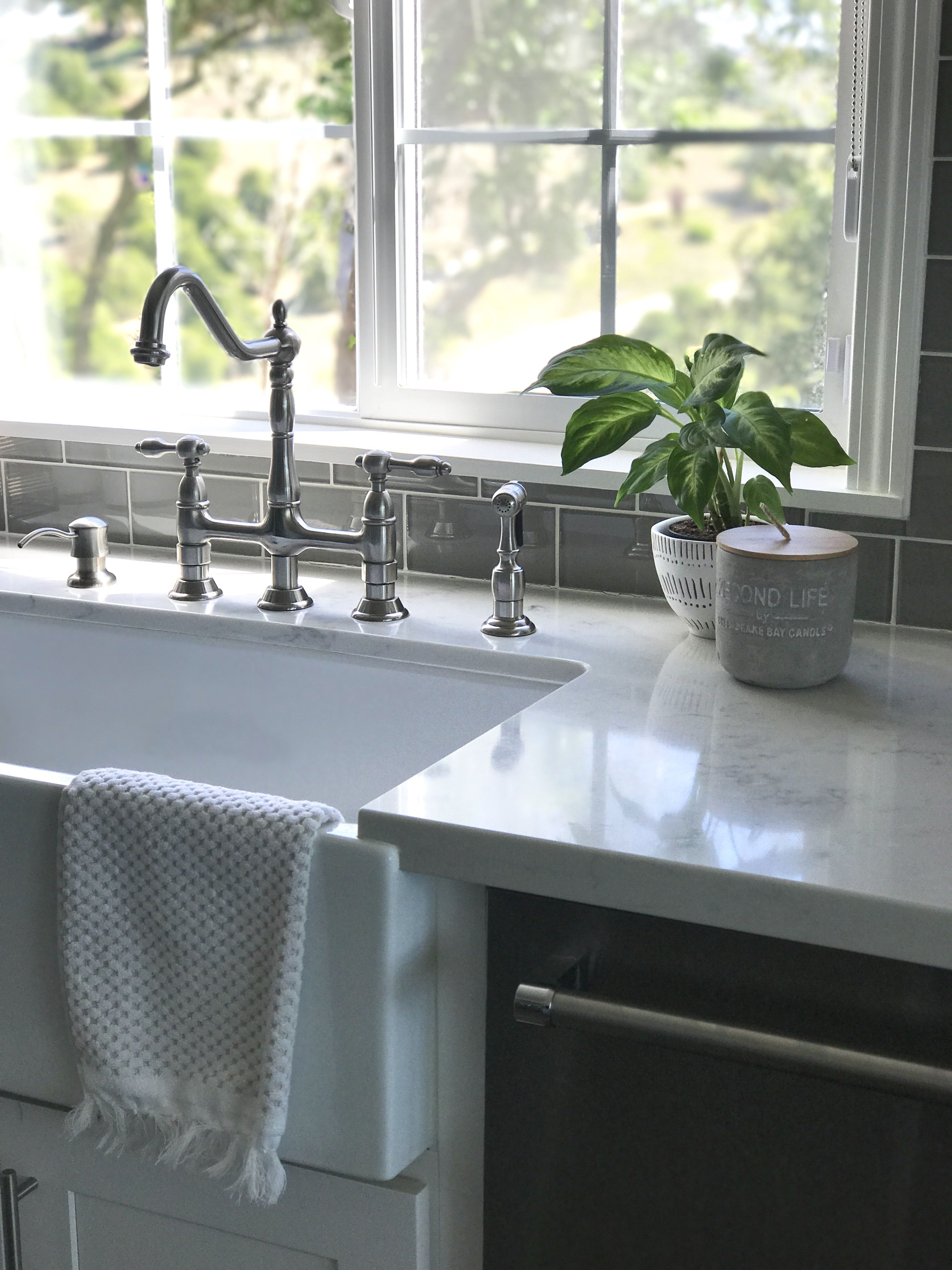 Farmhouse sink with white counters relaxed roman shade