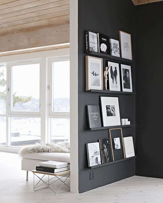 Black Painted Wall With Gallery Shelves For Picture Frames