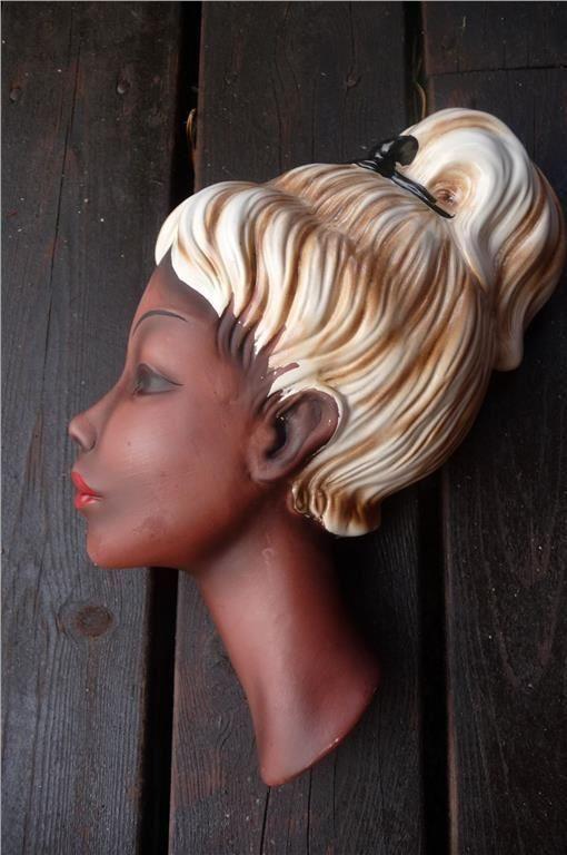 Annons på Tradera: retro kvinnohuvud för vägg.