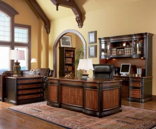 Dark wood furniture in a manly home office.