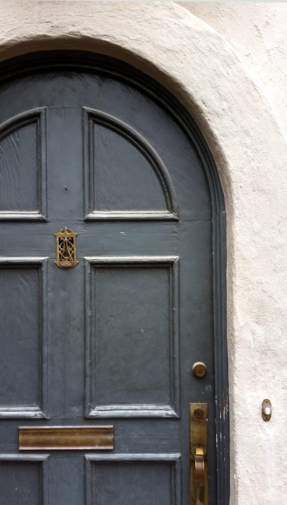 Slate Front Door Arched Front Door With Aged Brass Handle And Mail Slot Antique Door Byrd Design Creative Interior Design Arched Front Door Antique Door
