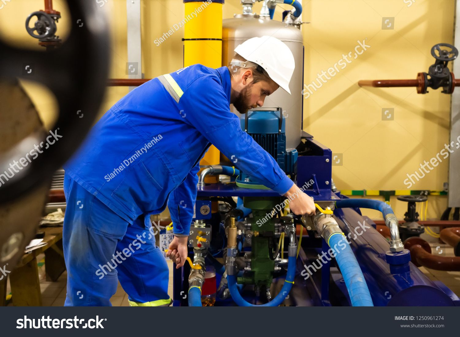Technician maintenance of industrial oil pump on factory