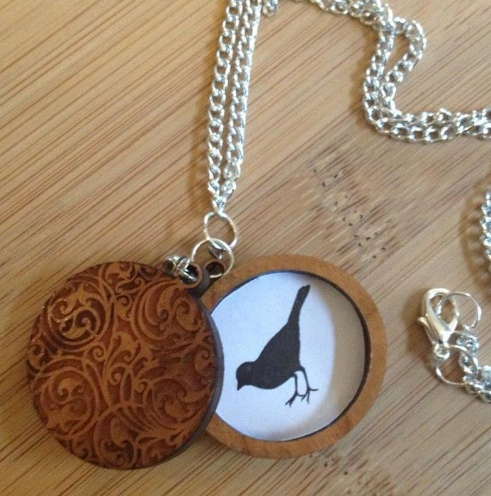 Gorgeous engraved wooden locket
