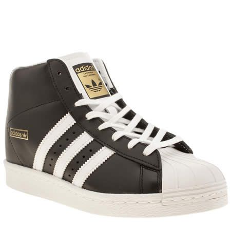 official photos 38f3a 5676c If you like the standard simple shell-toe trainer, then you re going to love  the adidas Superstar Up. This black leather wedge trainer features white ...