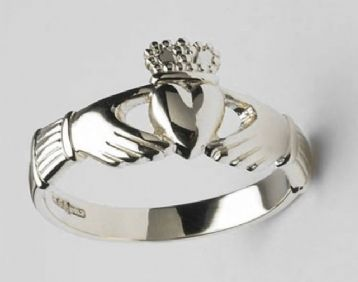 The Claddagh Ring.  Hands for friendship, heart for love and crown for loyalty.  The person who is married or in a relationship wears the ring with the point of the heart point towards them.