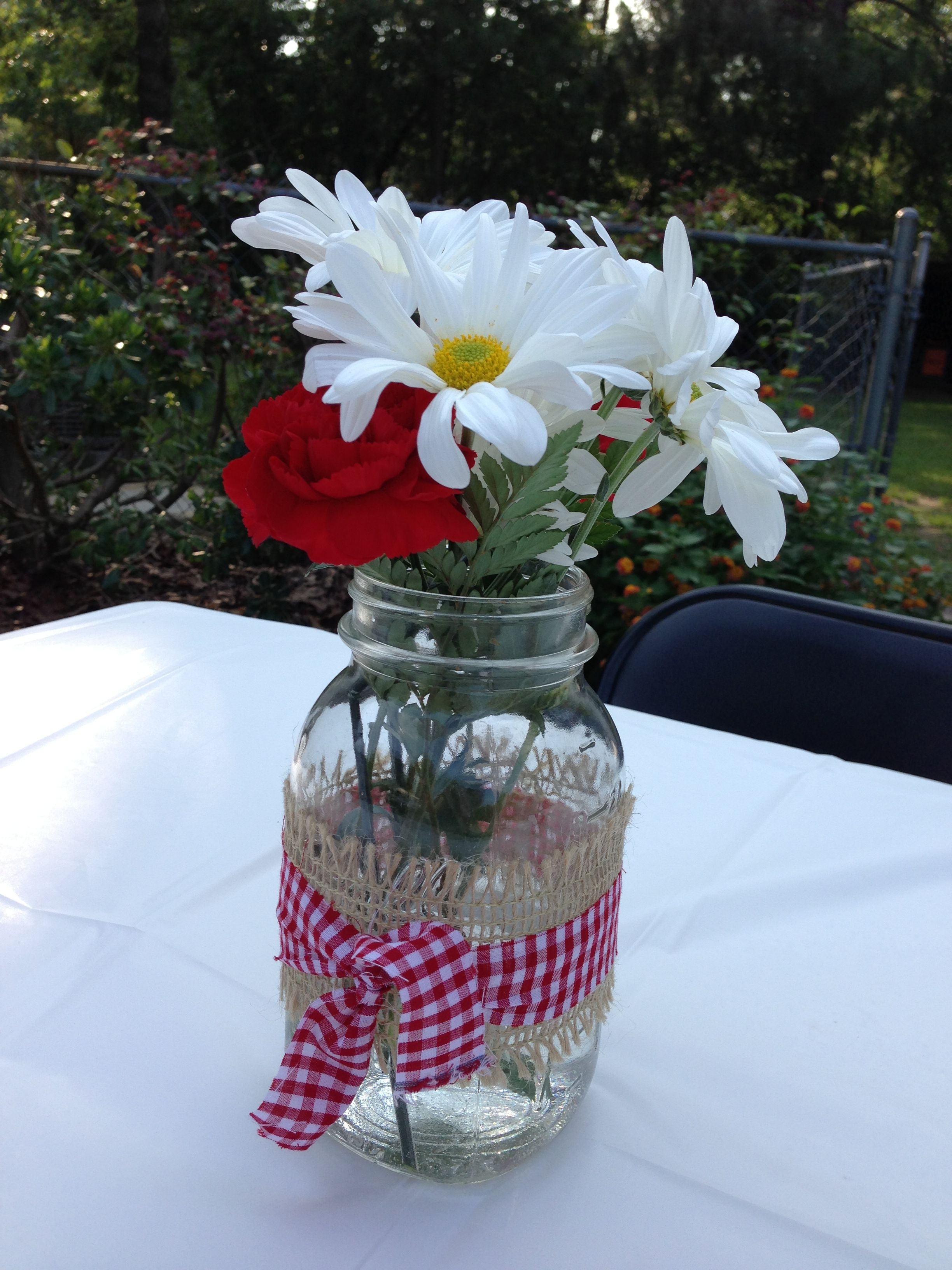 Flower Arrangement In A Mason Jar White Daisies And Red