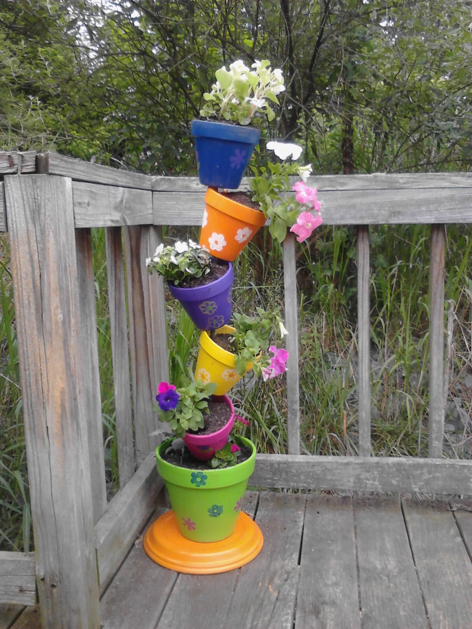 My DIY Instructions for a Tipsy Plant Tower is part of Garden crafts diy - My DIY Instructions for a Tipsy Plant Tower Intro I saw the idea for a really cute ceramic planter tower on Pinterest, but there were not detailed instructions on how to do it  I went to Lowe's and used one of their cool craft idea sheets and the photo from Pinterest to make my own versi