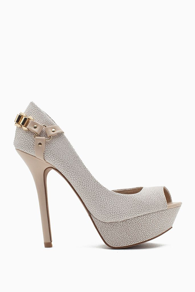 Harness your flirtiness in these killer platform pumps! Gold polished metal chain harness at counter. Cut-away inner side. Stingray-textured faux leather body. Peep toe. Exposed platform. High stiletto heel.