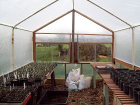 Greenhouse made from old metal carport frame, reclaimed ...