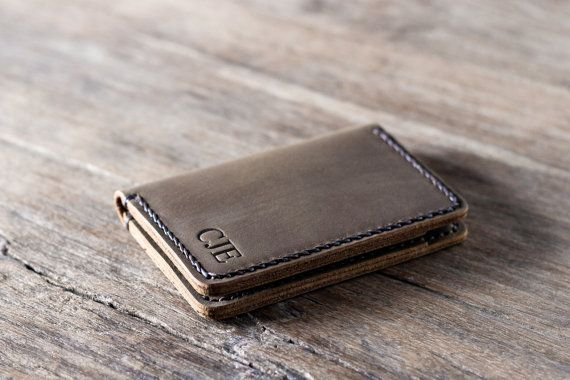 This listing is for one PERSONALIZED card wallet. We have branding awesome INITIALS into the leather down to an exact science.  This new front pocket wallet design is slim and fun. ————————————————————— [ PRODUCT FEATURES ] —————————————————————  ✦ When closed is measures 3 by 4.5 by 3/8 (7.5 cm by 11 cm by 1.1 cm) ✦ Holds 8 - 10 cards + folded cash ✦ Made from distressed, full-grain cowhide leather ✦ Our signature hand-stitching  Its a really fun wallet that is sure to impress, especially…