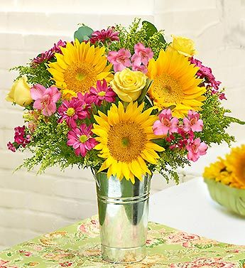 $49.99 Garden Pathway™ a vibrant mix of sunflowers, roses, alstromeria