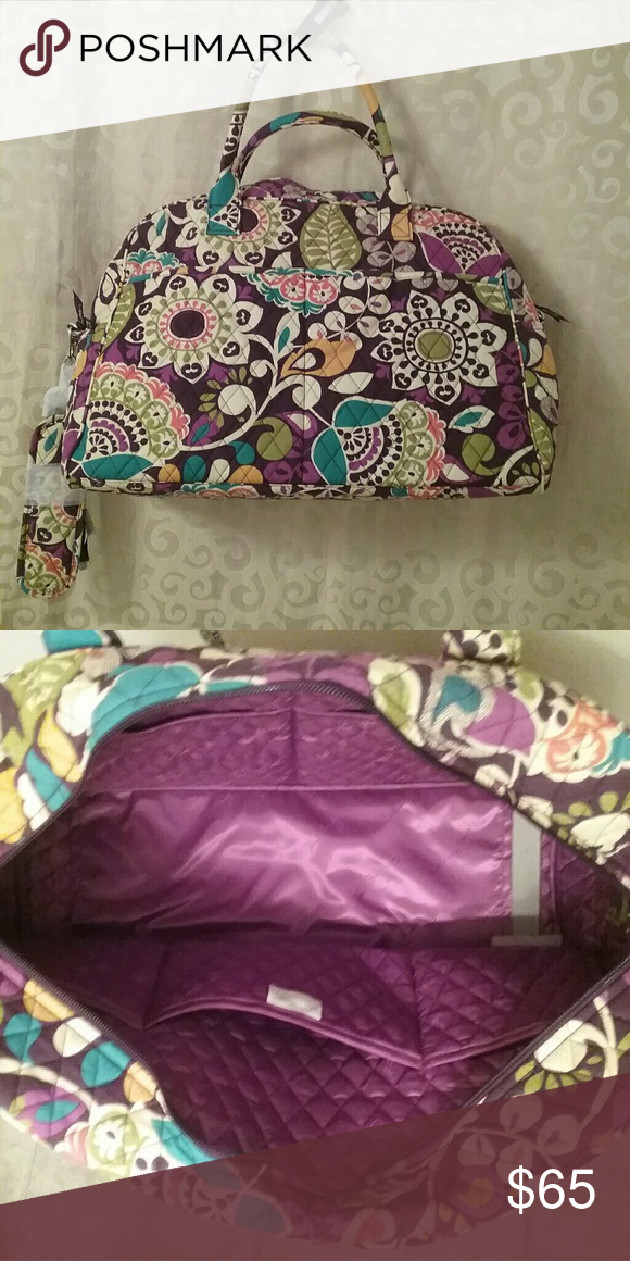 """NWT Vera Bradley Weekender Bag - Plum Crazy This is a large bag with lots of pouches and a shoulder strap. Inside there are 3 pockets on one side, and 2 on the other. Outside there are 2 large pockets on  one side and 2 smaller pockets on the other.  There is also a slot to fit over a luggage handle.  The top zips closed. The measurements are about  17 1/2"""" long, 13"""" high, and 7"""" deep at the base. Vera Bradley Bags Travel Bags"""