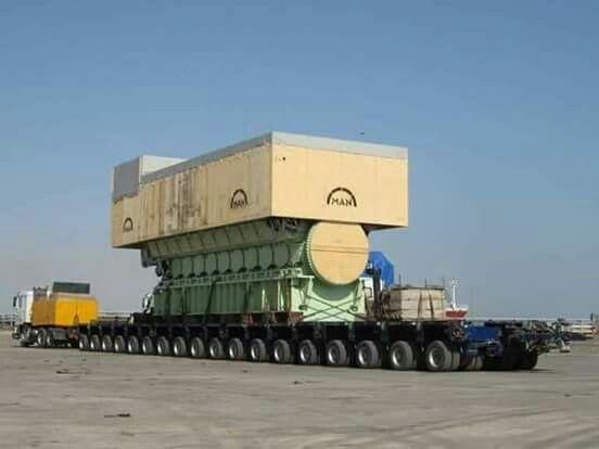 Huge 80 Wheeler Truck Transporting An Electrical Power Generator
