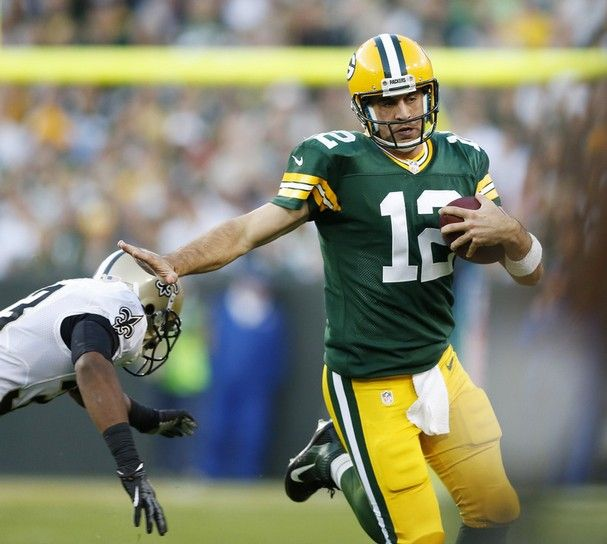Aaron Rodgers Giving Stiff Arm To Saints Defender In Week 5 Win Packers Packers Football Green Bay Packers