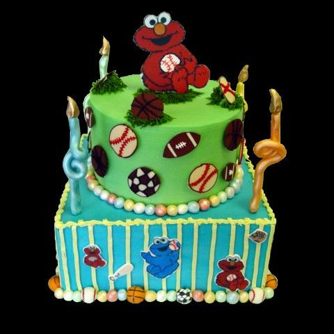 Go Team Elmo tops this soft frosted cake decorated with stripes