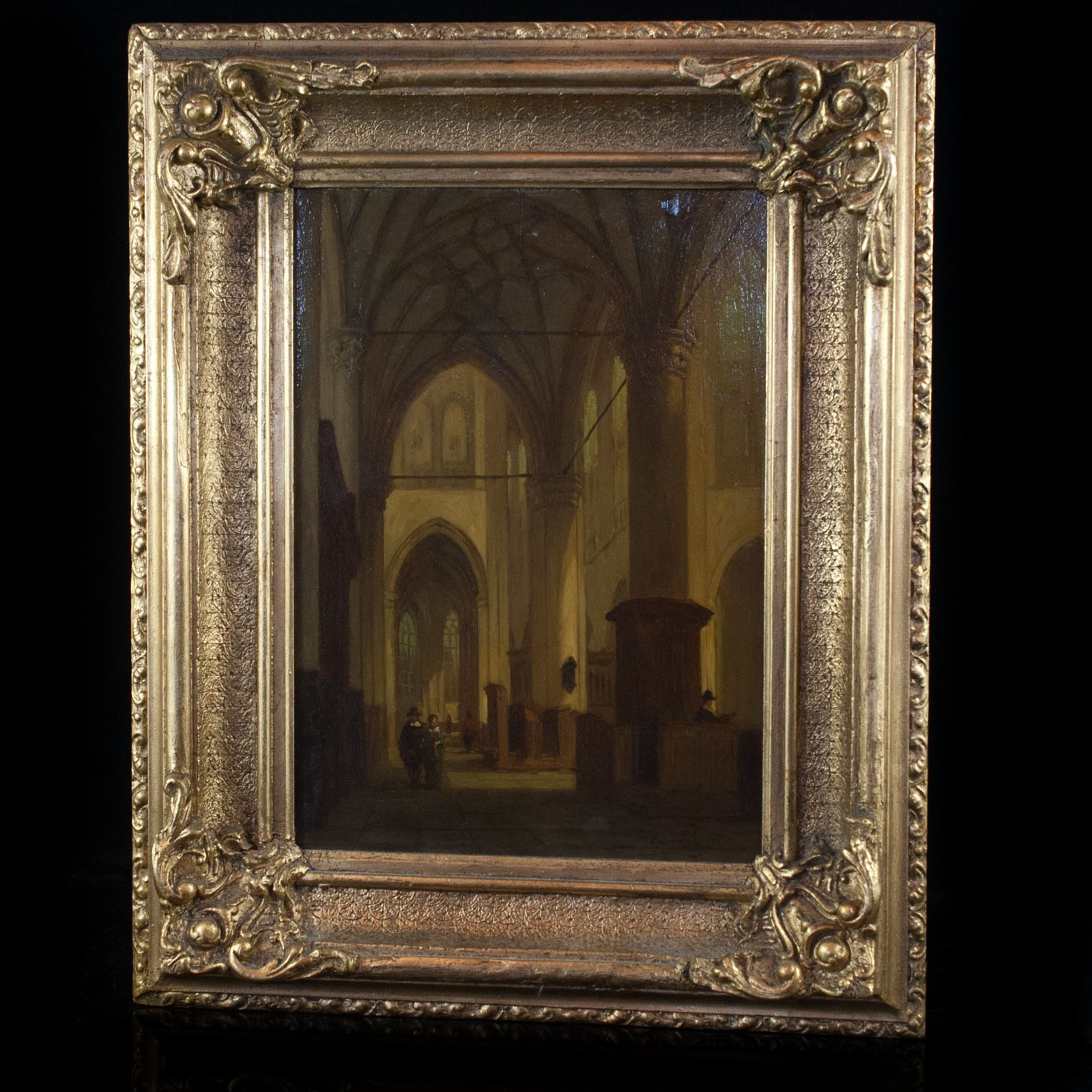 "Lot #202: Jan Baptiste Tetar van Elven (Dutch 1805 – 1879) This Oil on Panel Painting by Jan Baptise Tetar van Elven is signed ""Tetar van Elven"" (Bottom right). The Painting depicts a large cathedral interior. Surrounding the Painting is a finely detailed gilded wood frame.  CIRCA: 19th ORIGIN: Netherlands DIMENSIONS: 18 1/2″ x 15″"