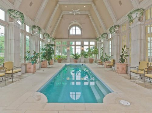 the indoor pool reminds us of a hilton hotel the master bedroom suite boasts his and her powder rooms a steam room an exercise room a hair salon and