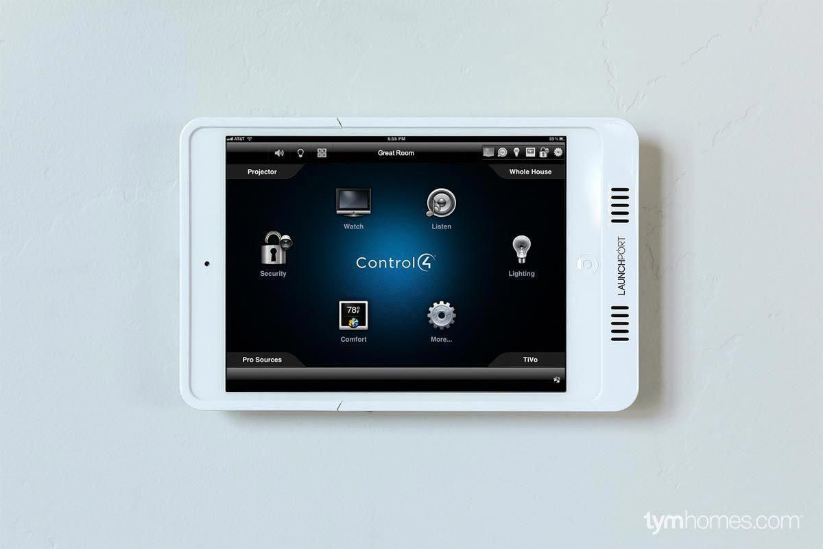 Control4 Pro Automation Controlled By A Wall Mounted Ipad With Launchport Wireless Inductive Charging Syst Home Automation Home Automation System Home Theater
