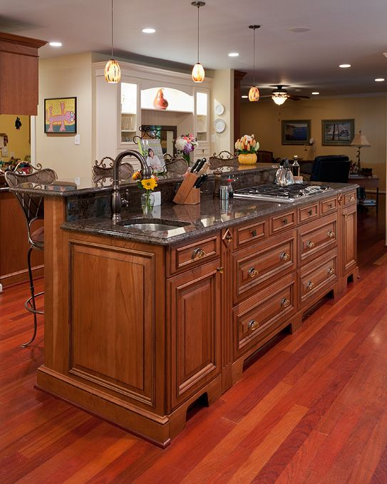 Islands with stoves the former island was small and did - Kitchen island with cooktop and seating ...