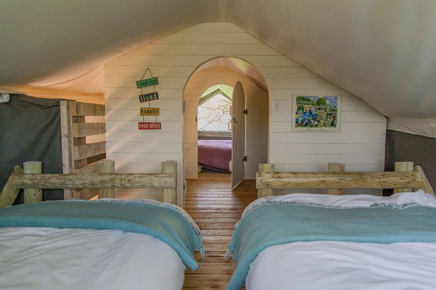 Mill Farm Glamping, Wiltshire. NEW! Squirrel Lodge is the UK's first two floor canvas lodge. Stylishly designed, it oozes a feel of luxury making it warm and welcoming for a glamping break on a whole new level http://www.organicholidays.com/at/2797.htm