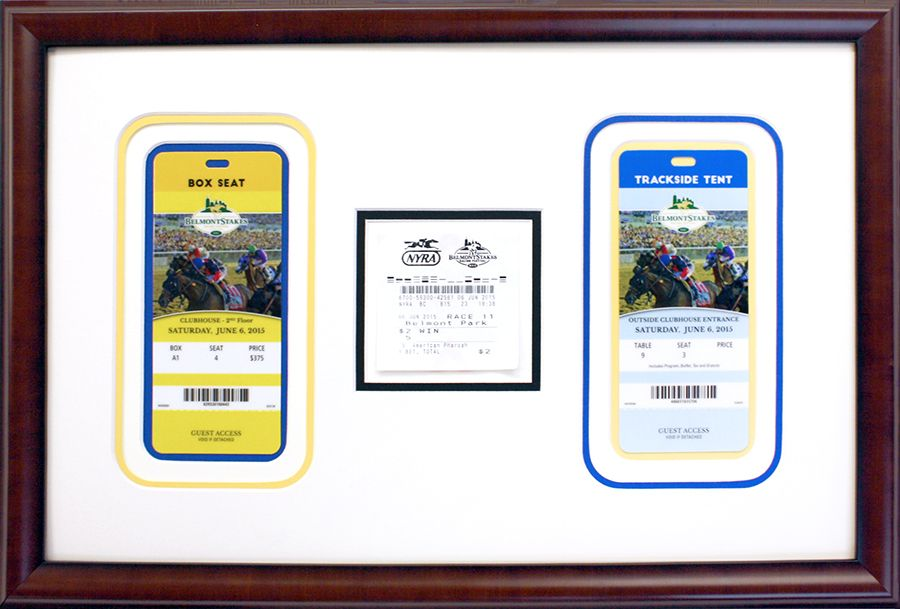 Horse racing tickets displayed in mahogany frame with multiple color ...