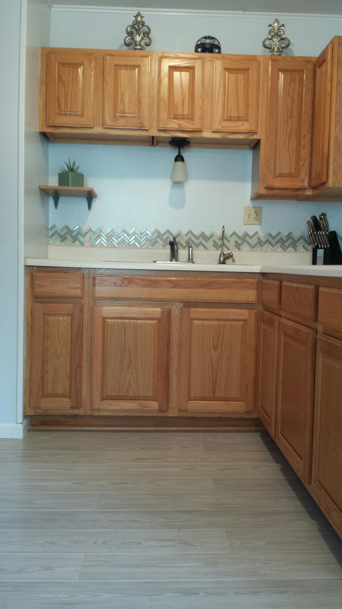 Honey oak kitchen cabinets with gray pergo willow lake for Grey wood kitchen cabinets