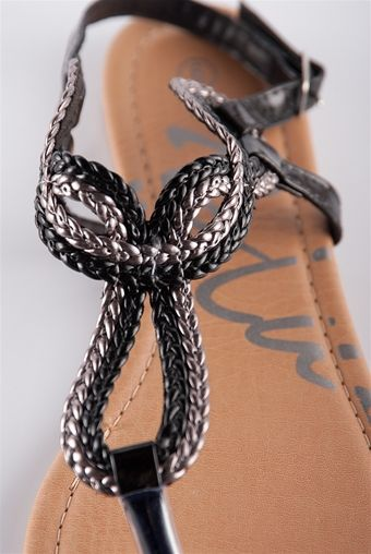 Braided Loop Sandal - Black $10.99 These sandals are really sweet! Featuring a braided loop over the top of the foot and a buckle closure around the ankle. http://paradiseinternetmall.net/
