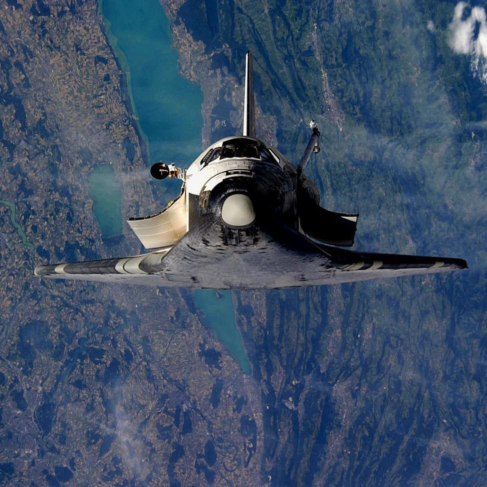 STS-114 Discovery flies over S...