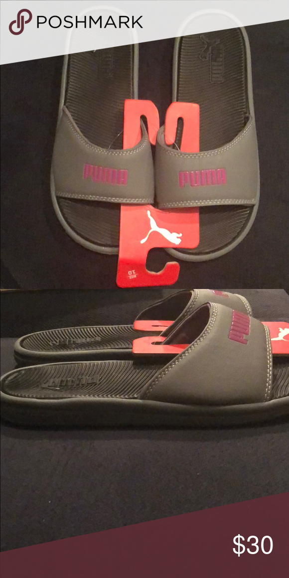 73925ba7b27 BRAND NEW PUMA SLIDES Never worn! Mint condition! Get these awesome dark  grey slides while you can!! Puma Shoes Athletic Shoes