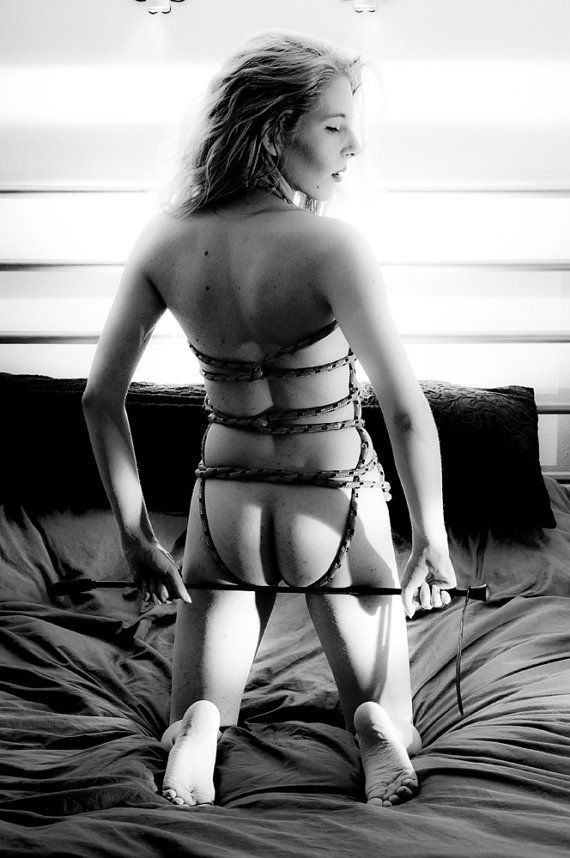 portrait of a woman tied up in rope black and white artistic nude