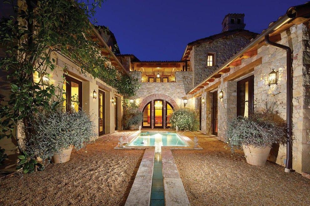 Crushed limestone mediterranean exterior decoration ideas for Mediterranean stone houses design