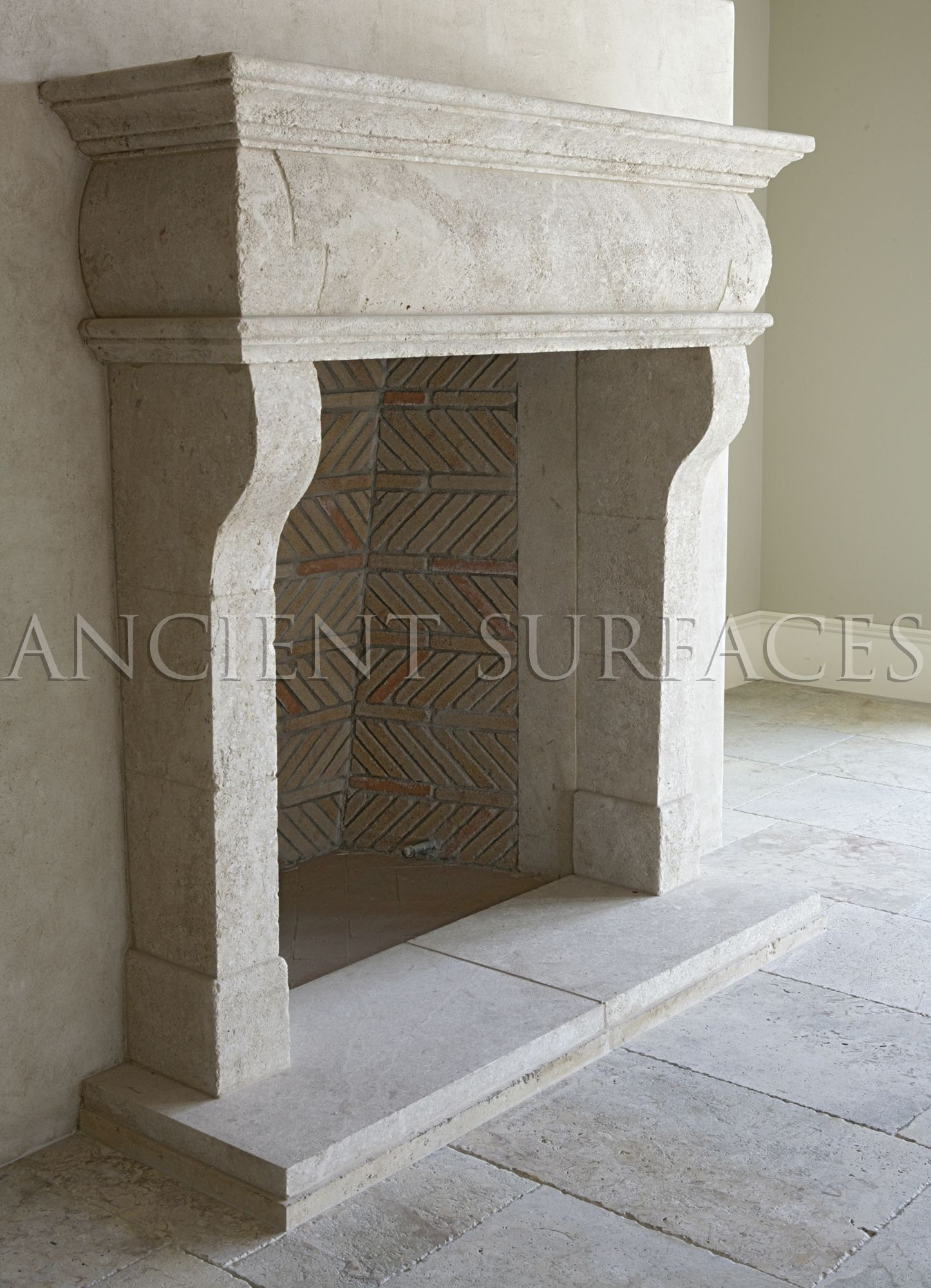 This Italian countryside fireplace was hand carved out of hard limestone  installed with an interesting herringbone - This Italian Countryside Fireplace Was Hand Carved Out Of Hard