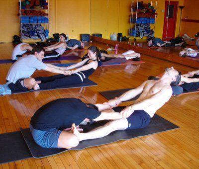 partner yoga pose butterfly pull yogaforbeginnershowtodo