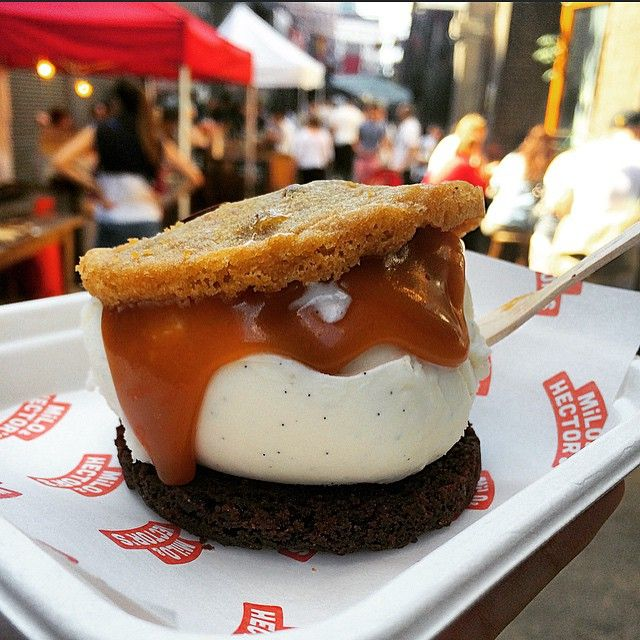 A vanilla ice cream sandwich encased in chocolate chip and chocolate fudge cookies with salted caramel sauce mmmmm from Milo & Hector's at Maltby Street Market, Bermondsey, SE1