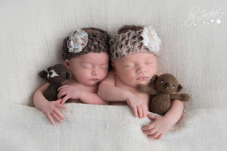 Photo of newborn baby twin girls snuggling hand made teddy bears by jackie photography between