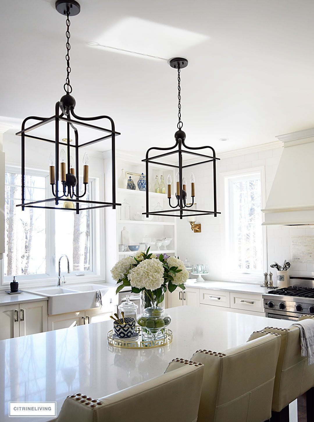 Bright and airy kitchen with two tone lantern style pendant lighting bright and airy kitchen with two tone lantern style pendant lighting over the island aloadofball Choice Image