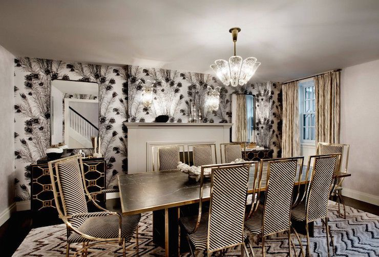 Stunning Dining Room Boasts A Glass Chandelier Illuminating A Black Marble  Dining Table With Gold Trim