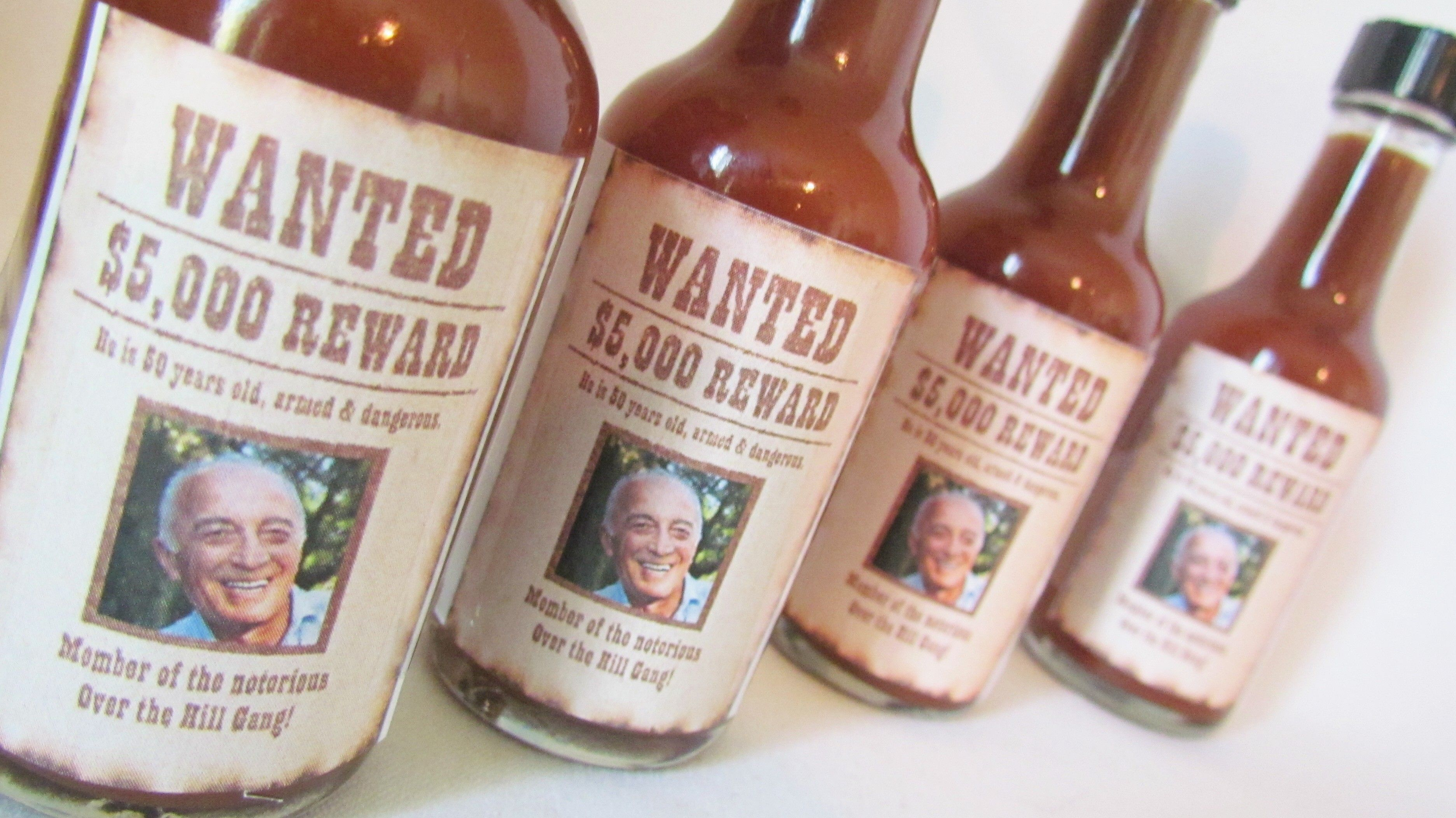 """Western theme 50th birthday party favors with a """"Wanted"""" poster"""
