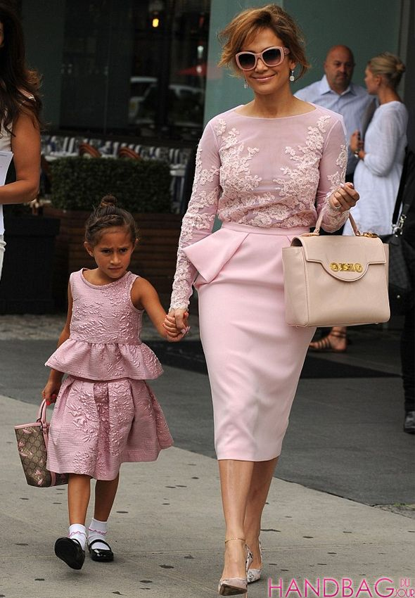 Jennifer Lopez and Emme look pretty in pink with Versace and Gucci bags -  See more 49965566ca8c1