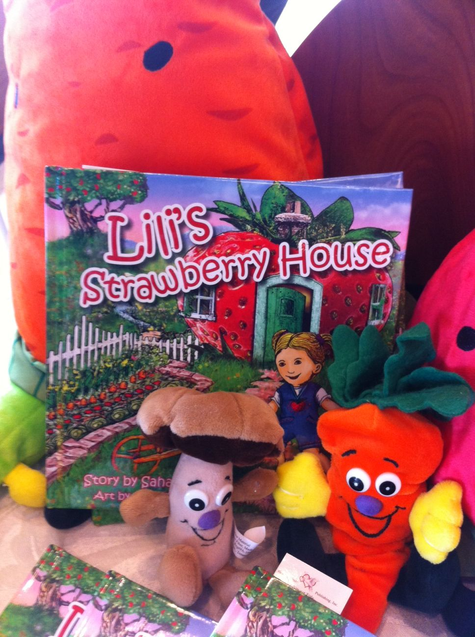 Colorful fruit and vegetable plush toys make reading Lili's Strawberry House book a great activity. www.lilistrawbhs.com