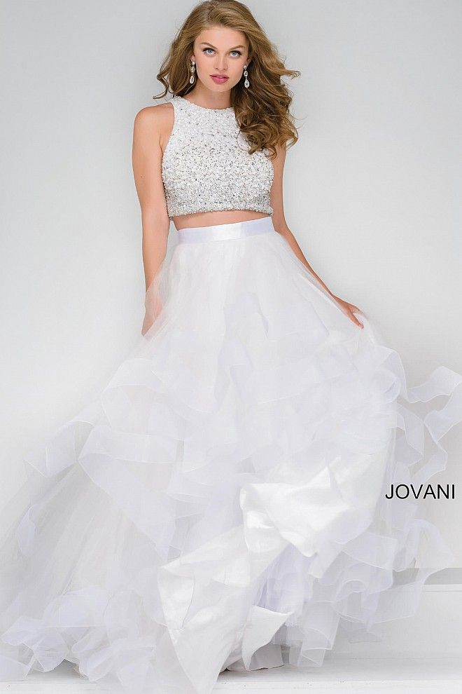 f7e9c786b9c Gorgeous white long fit and flare two piece prom dress features tulle  layered skirt with satin waistline and sleeveless fully beaded top