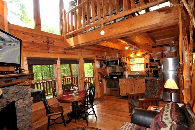Look Inside A Surprisingly Spacious Cabin With A Couple Of Surprises That Ll Make Your Day Log Home Kitchens Cabin Loft Sleeping Loft