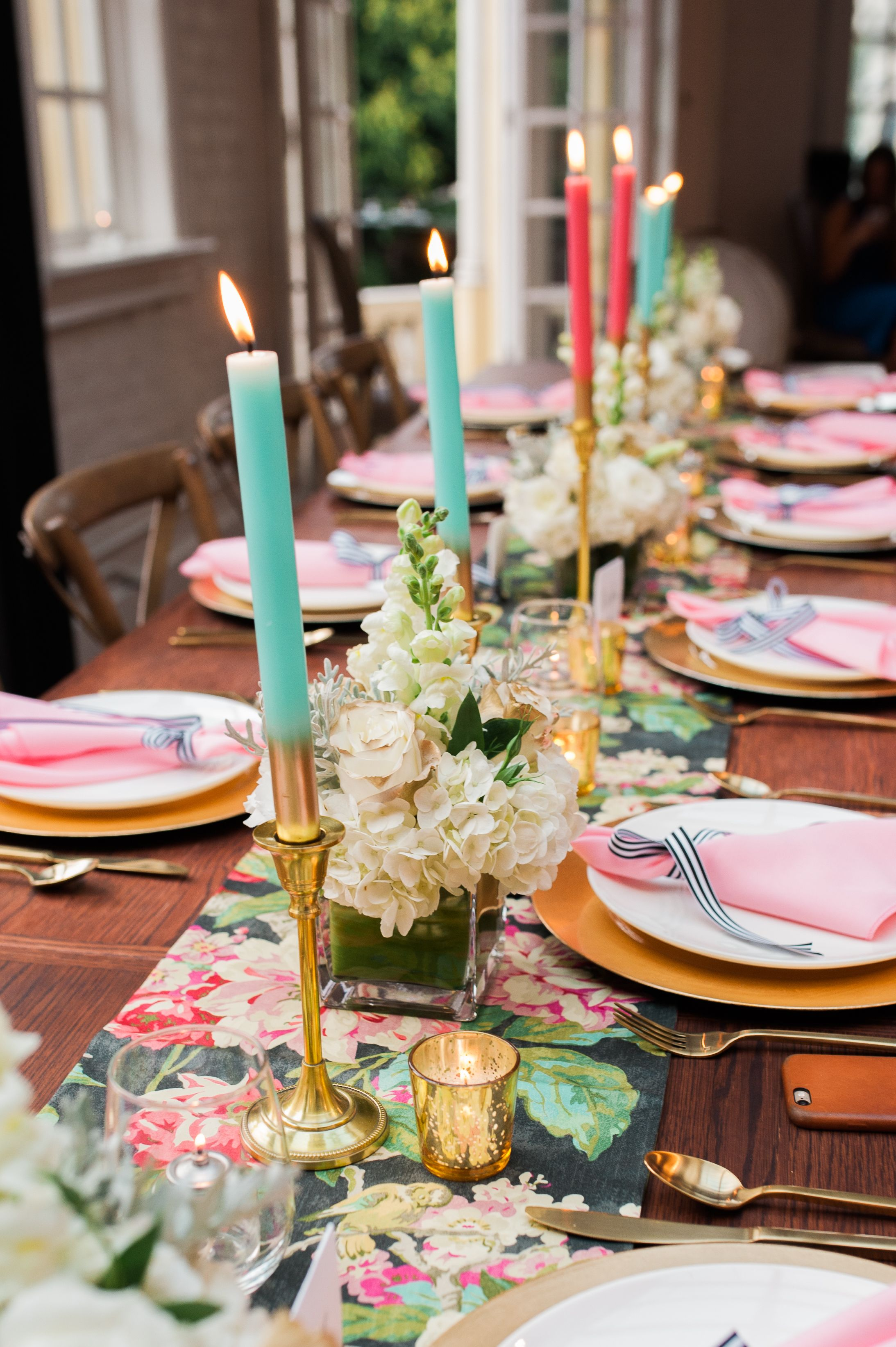 colorful candles light up this chic bridal shower table
