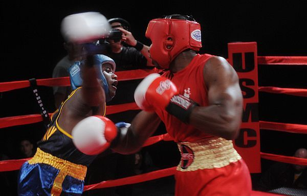 Hospital Corpsman Brandon Wicker (left), from Taunton, Mass., throws an overhand, right hook during a boxing match against Marine Cpl. Darnell Price in the bronze-medal bout of the 2012 Armed Forces Boxing Championship.