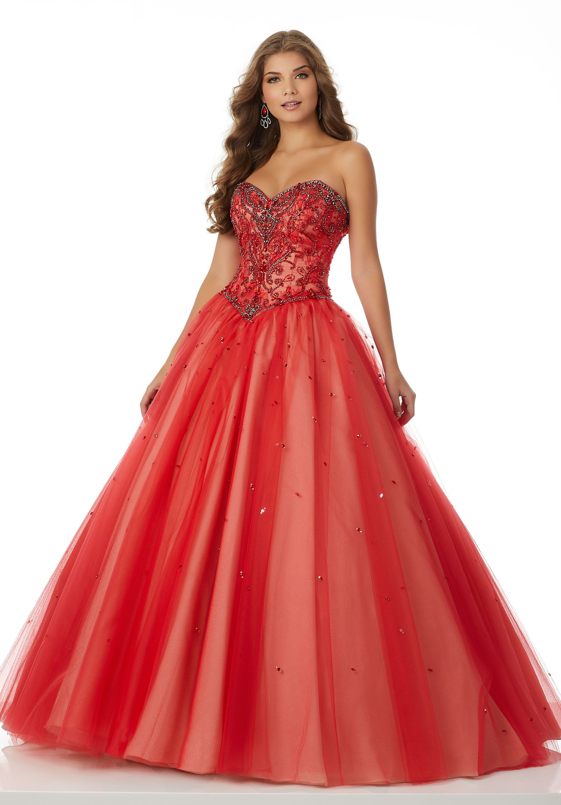 Classic tulle ballgown featuring a beaded lace sweetheart bodice and