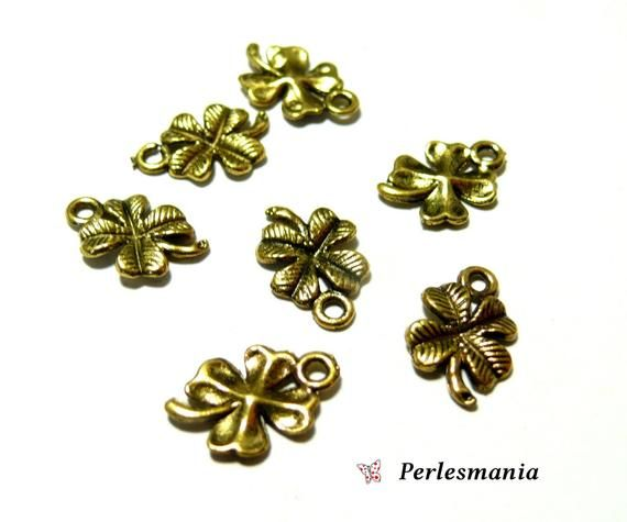 Supplies for jewelry: 40 charms Anhänger kleeblatt MIT Viel gold ref 141Dimensions: 11 by 17mmMaterials: metalNickel finishMake purchase perlesmania us www.facebook.com/perlesmania on liking