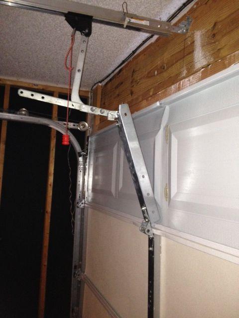 A Broken Garage Door Top Panel Very Common When The Garage Door Torsion Springs Are Getting W Broken Garage Door Garage Door Torsion Spring Garage Door Repair