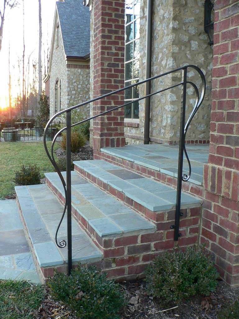Double top rail and long swirl ends Exterior handrail